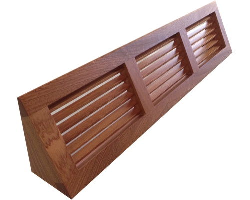 Baseboard Heating Duct : Wood baseboard vents angled to cover ducts